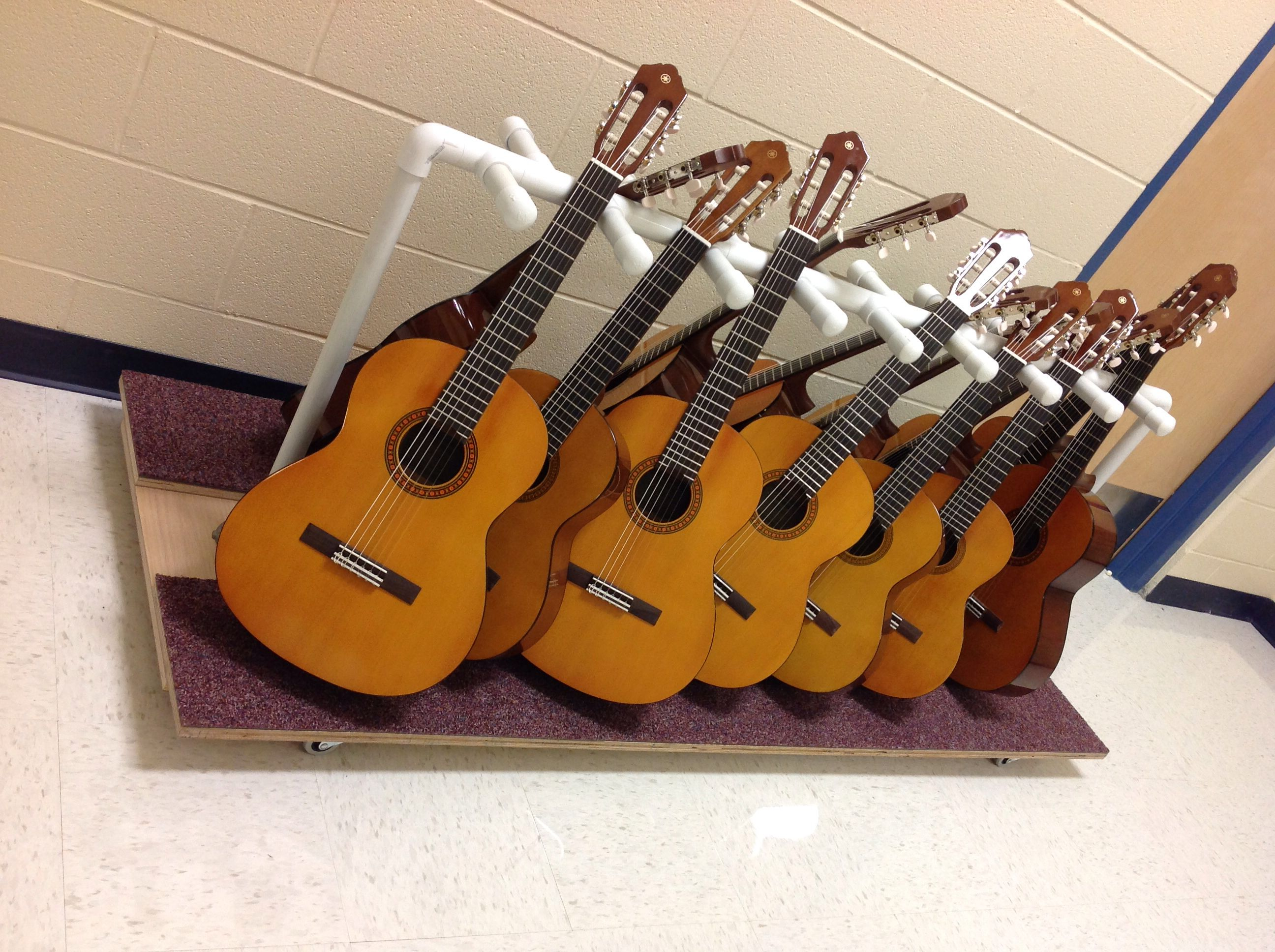 i made this guitar rack for los reyes elementary school it is on wheels for easy access and. Black Bedroom Furniture Sets. Home Design Ideas
