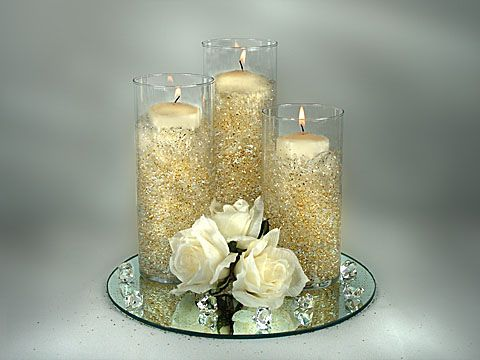 pillar vases with floating candles and glitter mirror wedding centerpiecescenterpiece