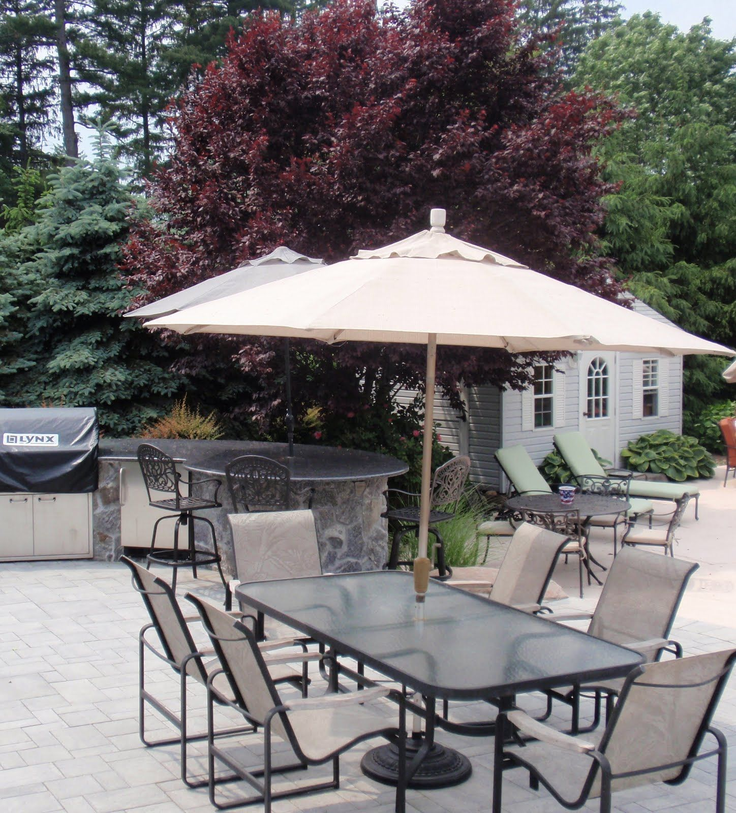 Patio Table Umbrella In White Furnished Among Grey Chairs