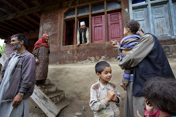 Liaqat Ali Shah, center, in his house in Lolab Valley, Kashmir, is one of hundreds of fighters trained in Pakistan-controlled territory who have returned home. Kuni Takahashi for The New York Times