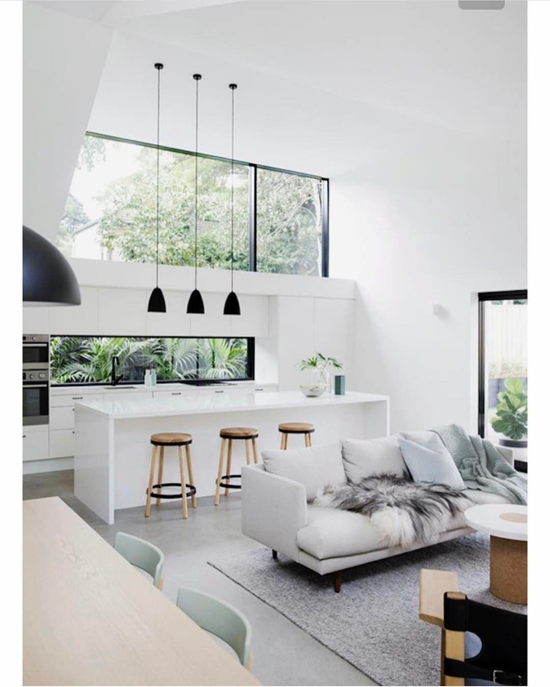 The full height shot of this stunning light filled home is even ...