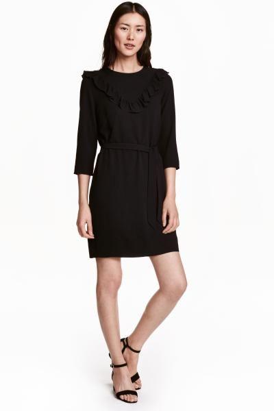 Modelos de vestidos cortos con manga tres cuartos
