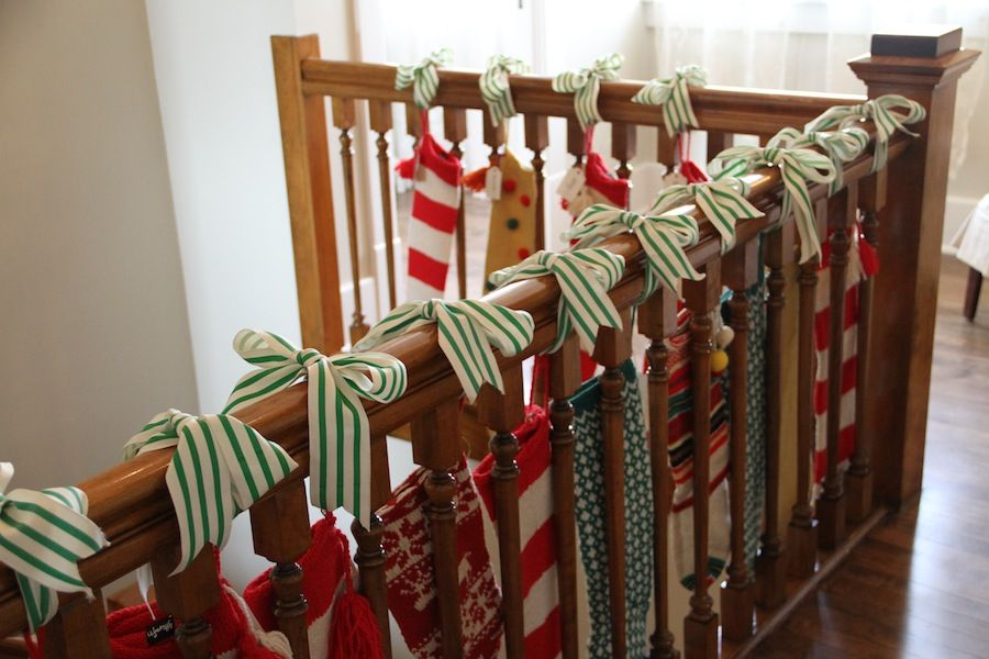 Hang stockings on the stair rail with ribbon great idea - Christmas decorations for stair rail ...