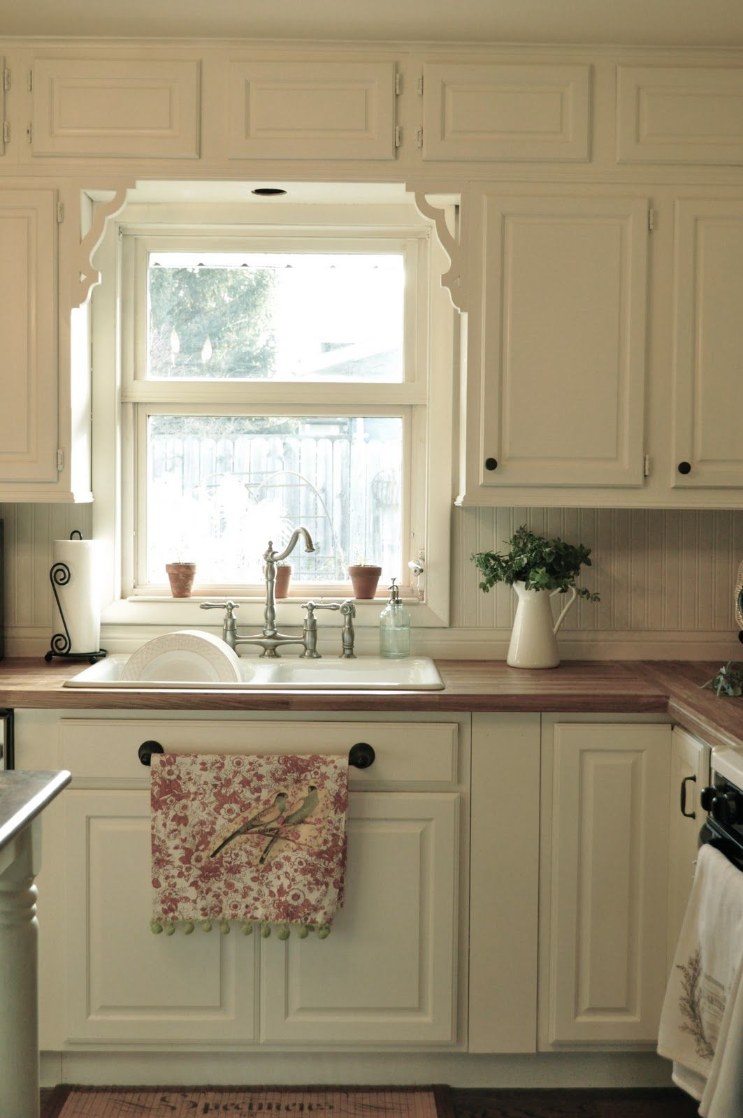 I love the wood countertops and white cabinets kitchen