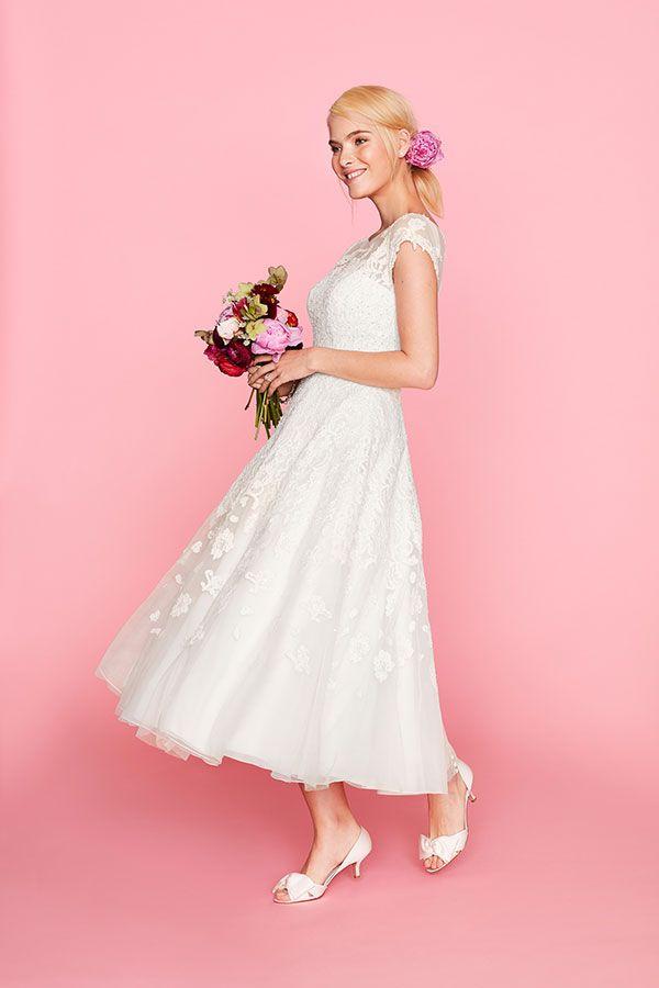 Oleg Cassini\'s short wedding dress with a classic boatneck cap ...