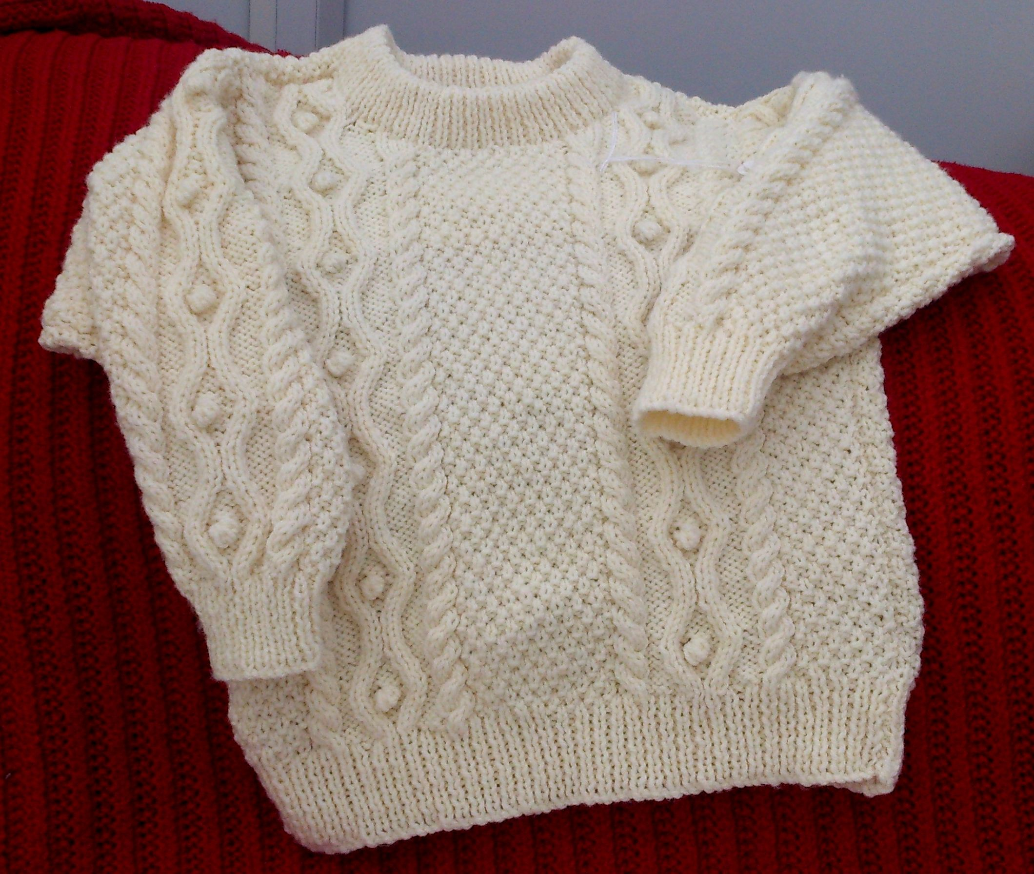 """An Aran style jumper because spring can still have chilly days. 24""""/61cm chest, in machine washable acrylic, this double knit weight jumper is £11.00 + signed delivery to the UK mainland @ £4.00 Message me for further details or to order, view at Crafters' Corner, on their special day 7th May. Well worth a visit."""