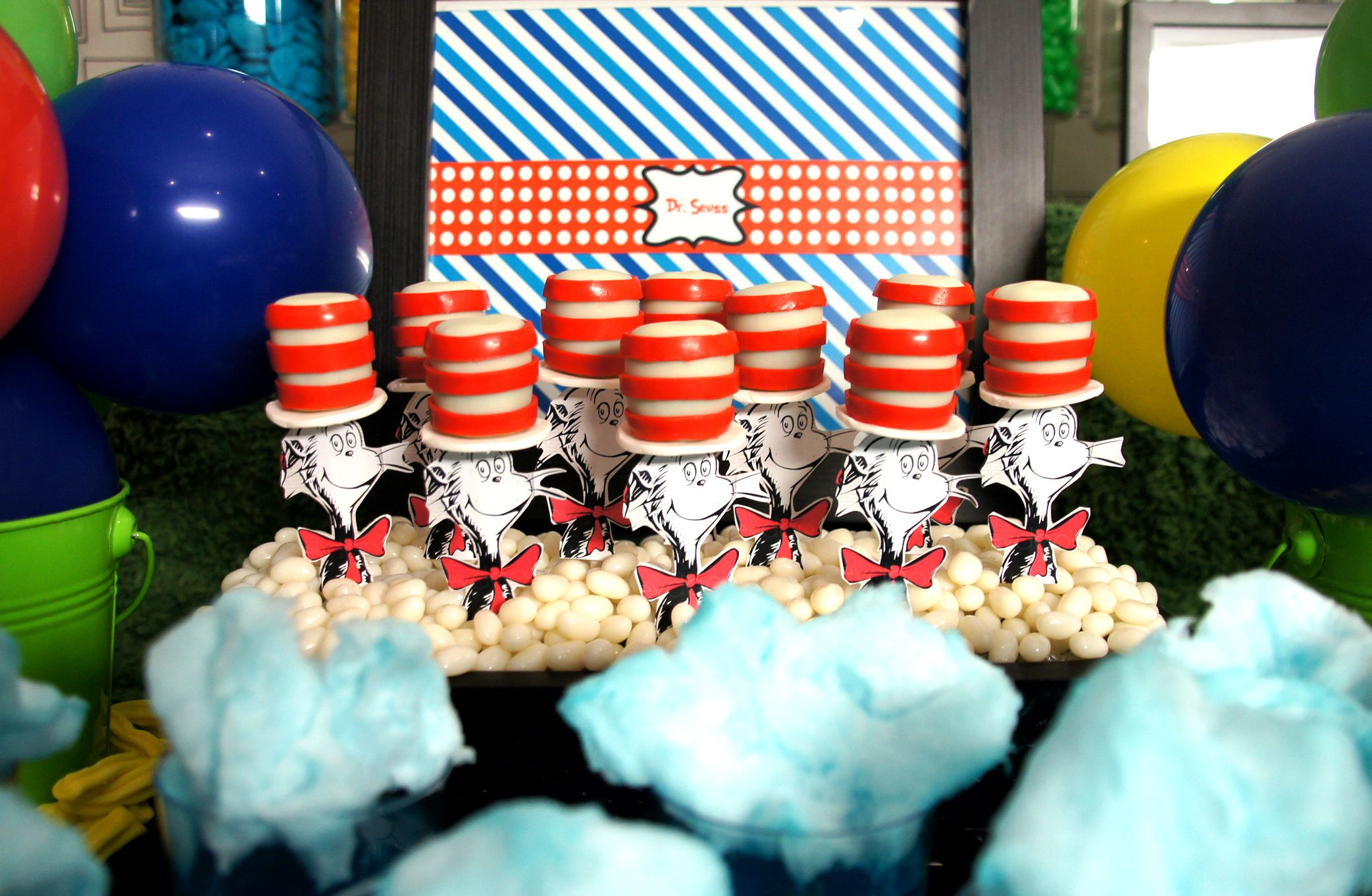 Dr Seuss table design & set up by The Simple Party  Cake pops by sugarpopbakery Printables from Printabelle