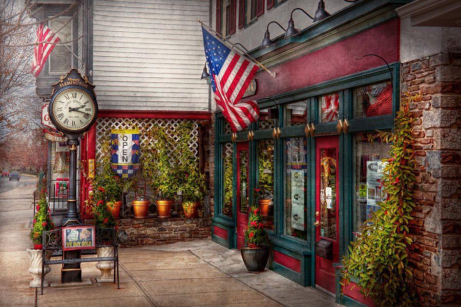 Store - Flemington Nj - Historic Flemington Fine Art Print Preciosa obra de arte plasmada en la fachada con una bandera americana ondeante