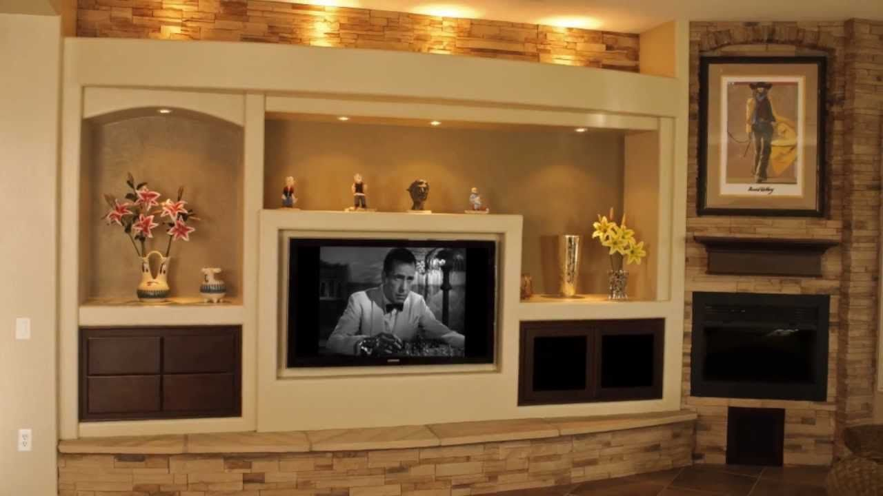 Built In Entertainment Center Design Ideas glorious white wooden fireplace entertainment center with bookshelves also ceiling lights as modern white family room decorating ideas Thunderbird Custom Design Custom Media Walls Drywall Entertainment