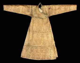 A MONGOL 'CLOTH OF GOLD' SILK AND METAL THREAD ROBE CENTRAL ASIA, LATE 13TH OR 14TH CENTURY Of silk woven with a bold design of burnished gold lotus vine on a ground of bold floral designs, with long pleated flaring skirt, long tapering sleeves, the remains of panels of similar contrasting silks forming the collar bands, with original mid blue cotton plainweave lining. 57in. (145cm.) long; 74½in. (189cm.) cuff to cuff
