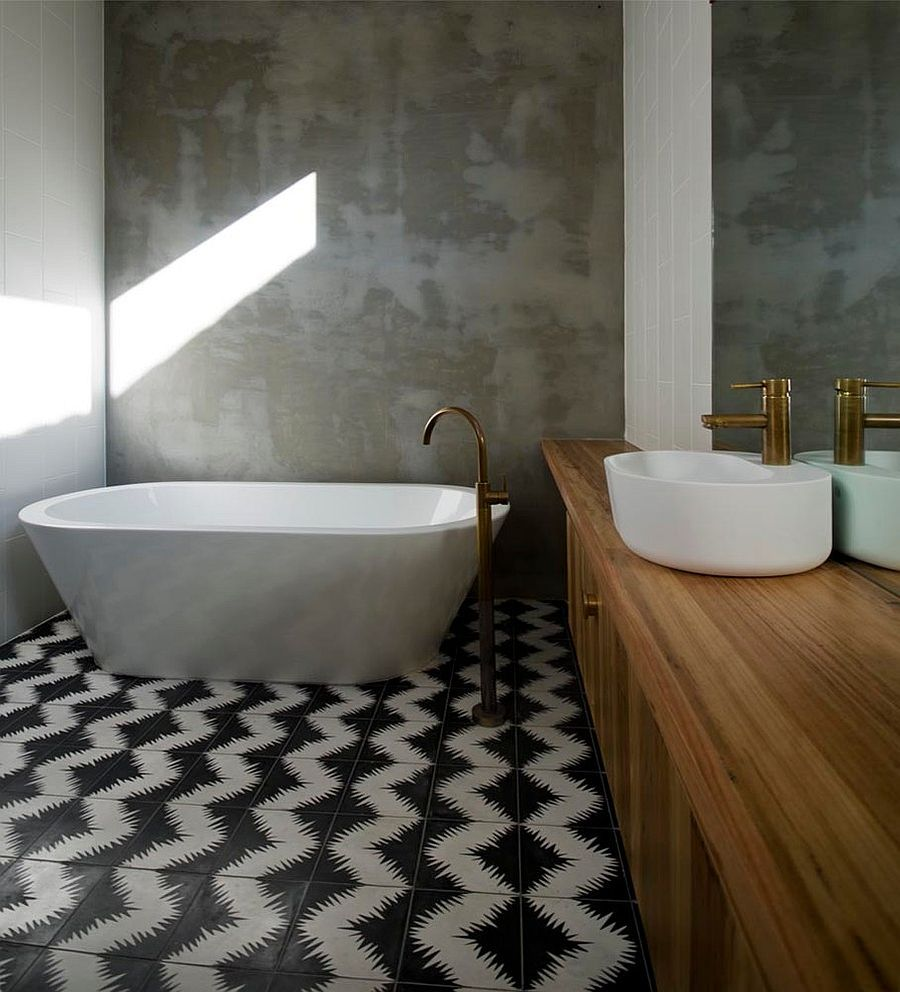 25 creative geometric tile ideas that bring excitement to your home rendered concrete walls of the bathroom stand in contrast to the geometric cement tiles design dailygadgetfo Choice Image