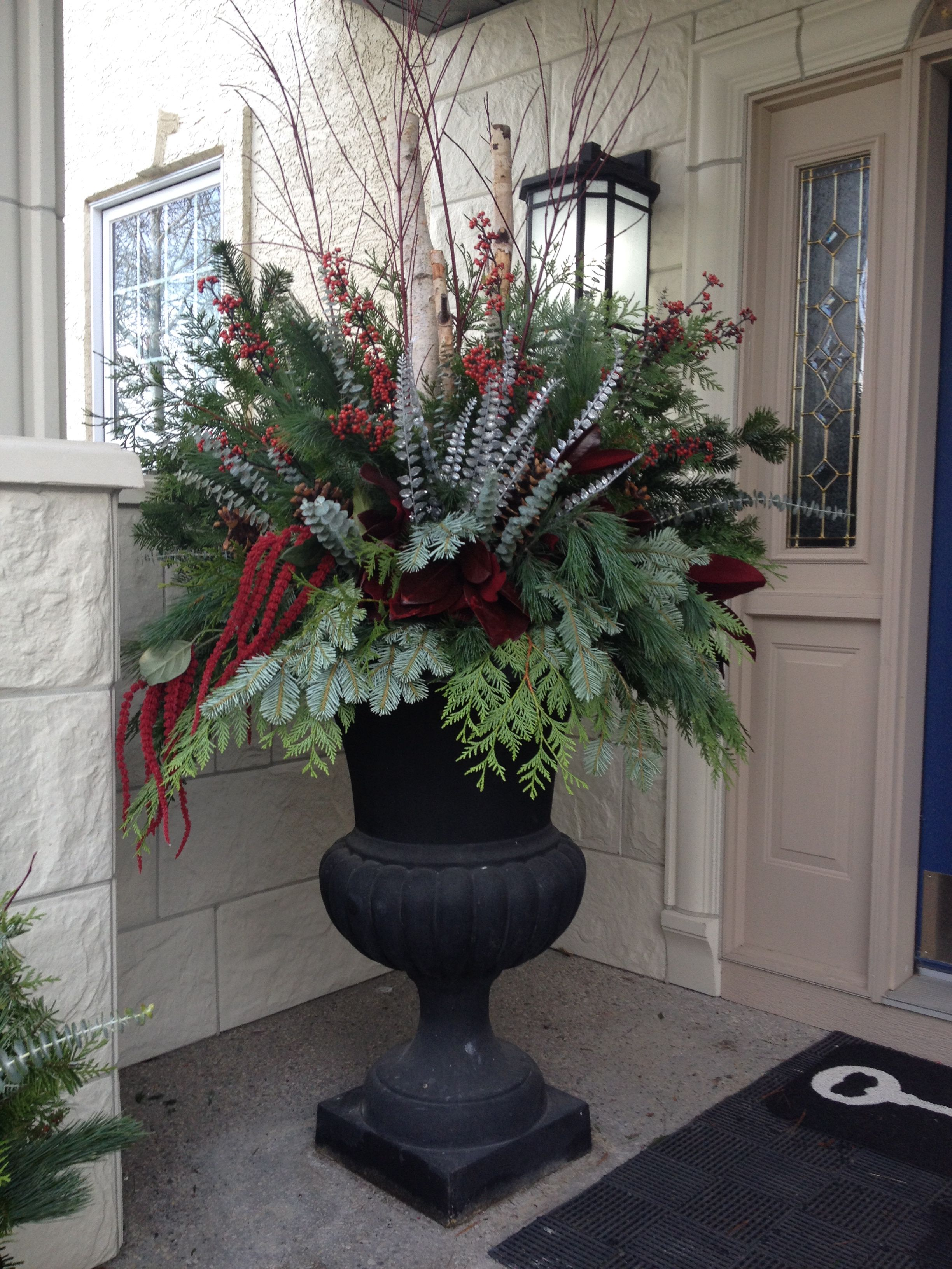 Red And Silver Urn Arrangement Christmas Decorations Christmas Planters Outdoor Christmas