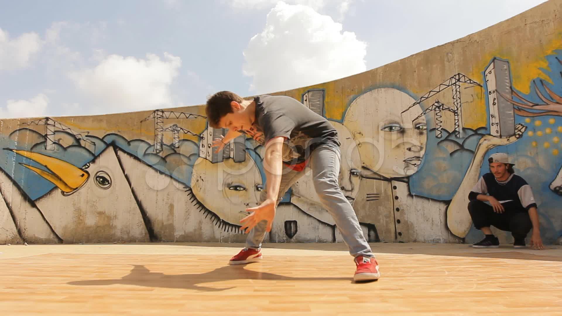 Cool Hiphop Teenager dancer dancing breakdance in action