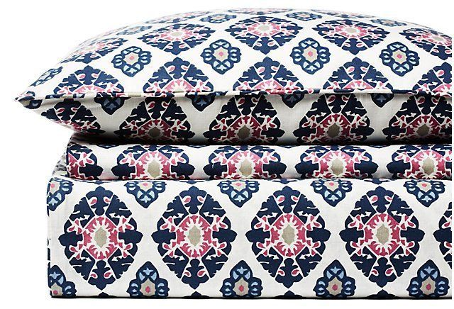 Masterfully crafted using a blend of washed cotton and linen yarns for added texture and softness, this duvet set is printed with a colorful droplet medallion design.Exclusively One Kings Lane's...