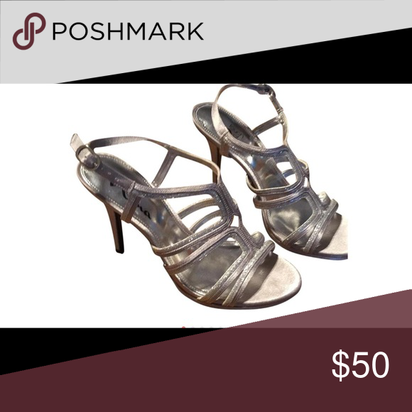 Beautiful shimmery silver slingback heels Mint condition silver shimmery heels worn only a few times. Extremely comfortable and  probably the prettiest heal you could wear with anything to either dress it up or to complete the your look!! Nina Shoes Heels