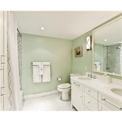 Soothing Pale Green And White Bathroom With Touches Of Silver Chrome
