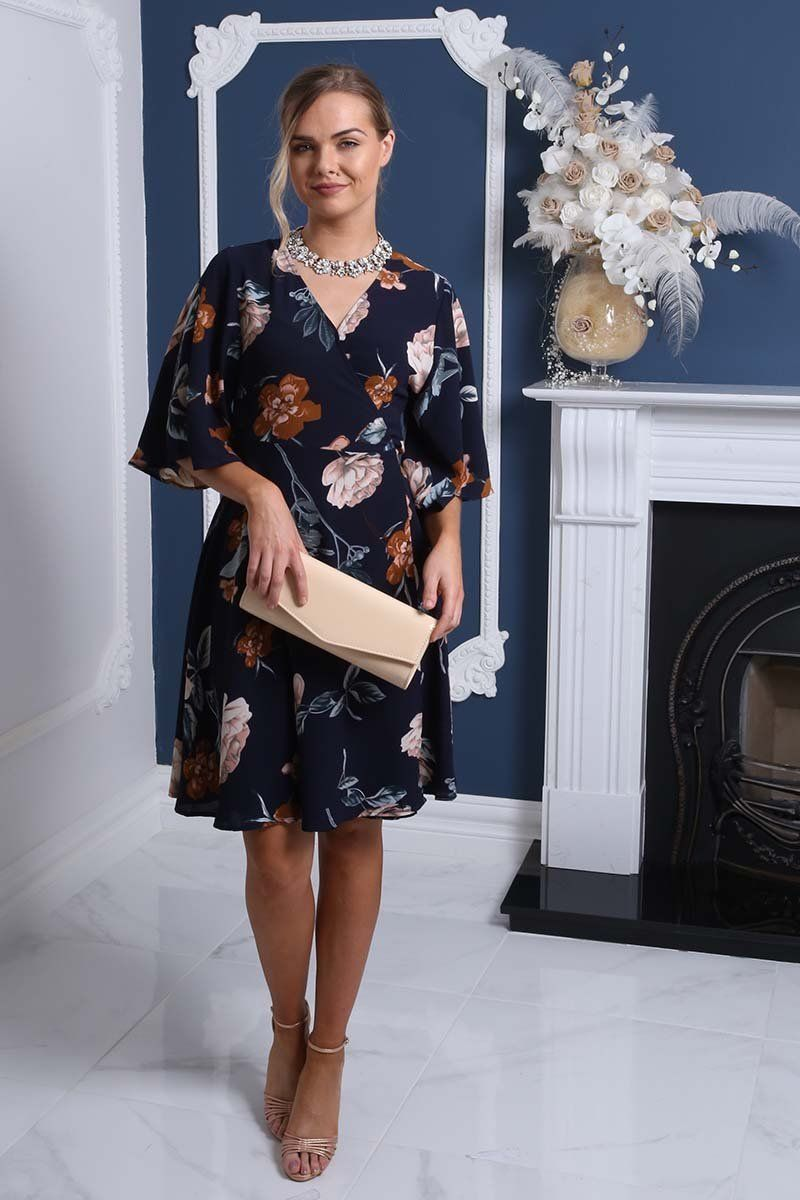 d76af94a65b I just adore this gorgeous wrap front tea dress! The navy blue flower print  pattern
