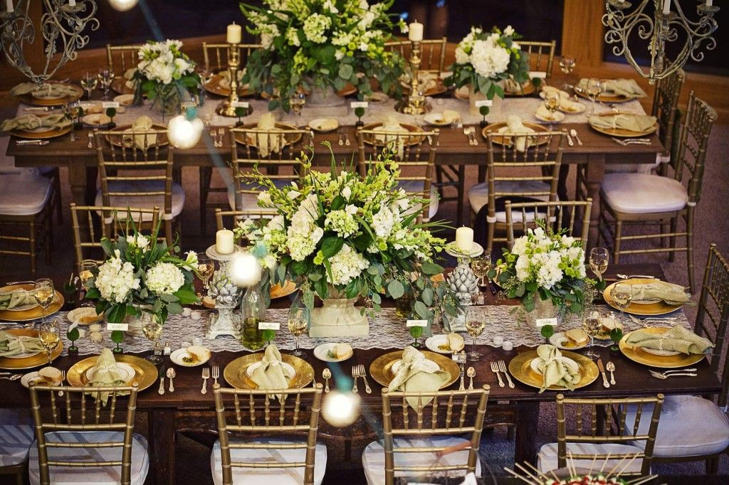 Photo via | Green centerpieces, Gold chargers and Rustic wedding flowers