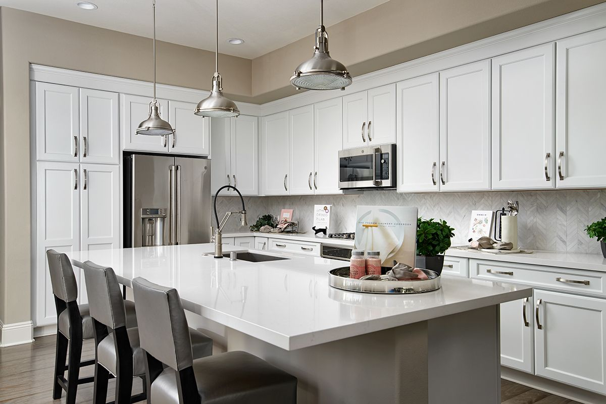 White Cabinetry Stainless Steel Appliances Eden Model Home Kitchen Irvine California Richmo Home Kitchens Richmond American Homes Home Building Design