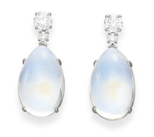 A PAIR OF MOONSTONE AND DIAMOND EAR PENDANTS, BY TIFFANY & CO.   Each suspending a detachable cabochon moonstone drop, from a circular-cut diamond link, to the the larger circular-cut diamond surmount, mounted in platinum, in a Tiffany & Co. black suede case  Signed Tiffany & Co., no. 21091383