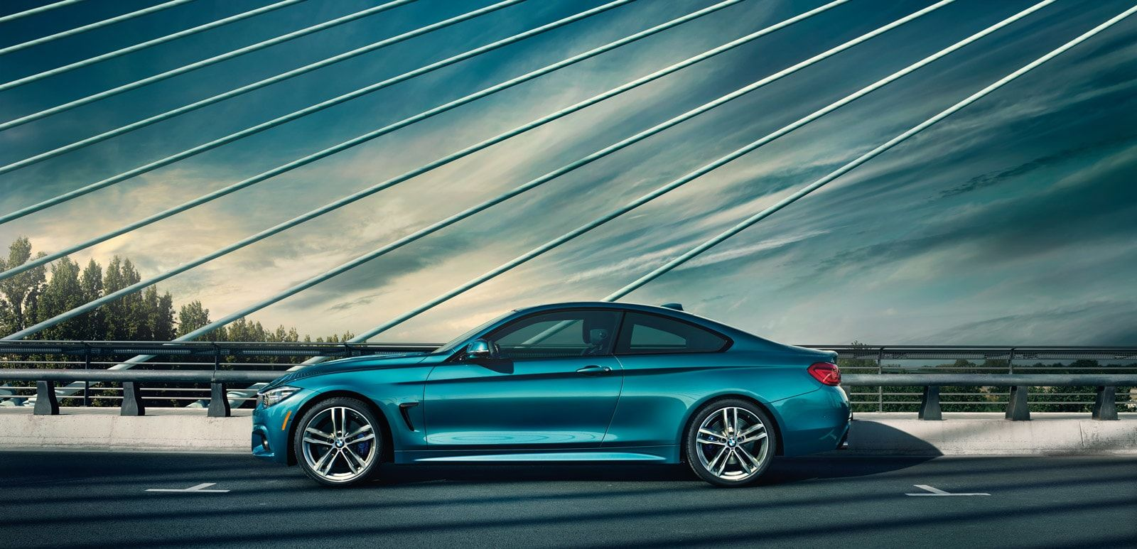 Profile Shot Of The 2019 Bmw 4 Series Coupe Parked On A Suspension