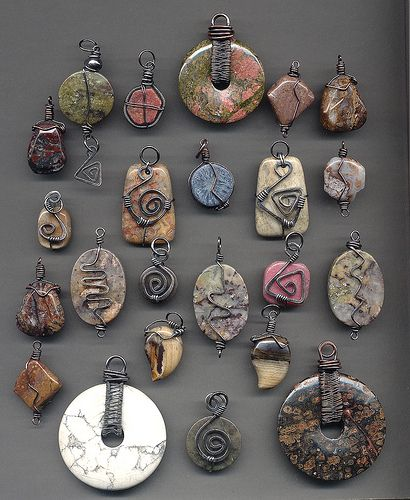 Photo of Stone and wire wrapped pendants after oxidizing