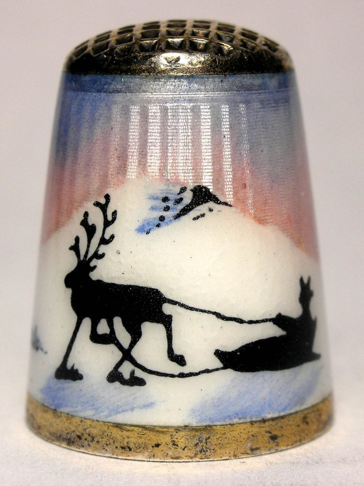 This fantastic sterling silver with vermeil finish and guilloche enamel thimble was made by Aksel Holmsen of Sandefjord, Norway in the 1930s. It depicts a Sami (indigenous people of the Arctic region) on a sled being pulled by a Reindeer's marked with the Holmsen trademark and 925S on the rim with 3 crowns in an oval and S inside the top denoting it as an import into Sweden. | eBay!