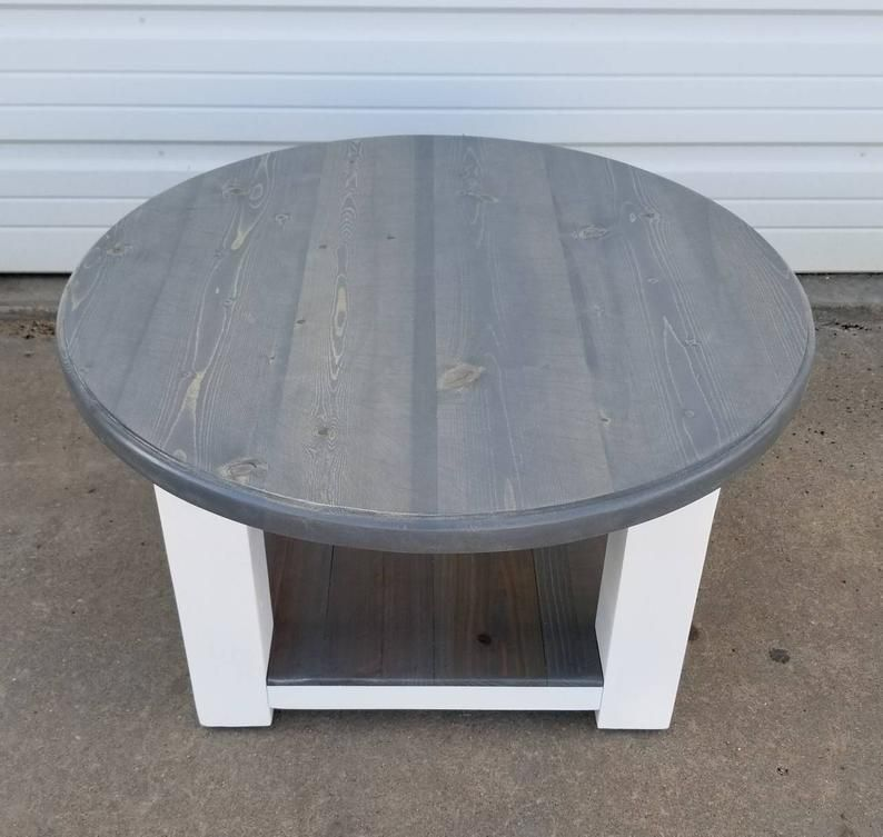 Round farmhouse coffee table with gray stained top and