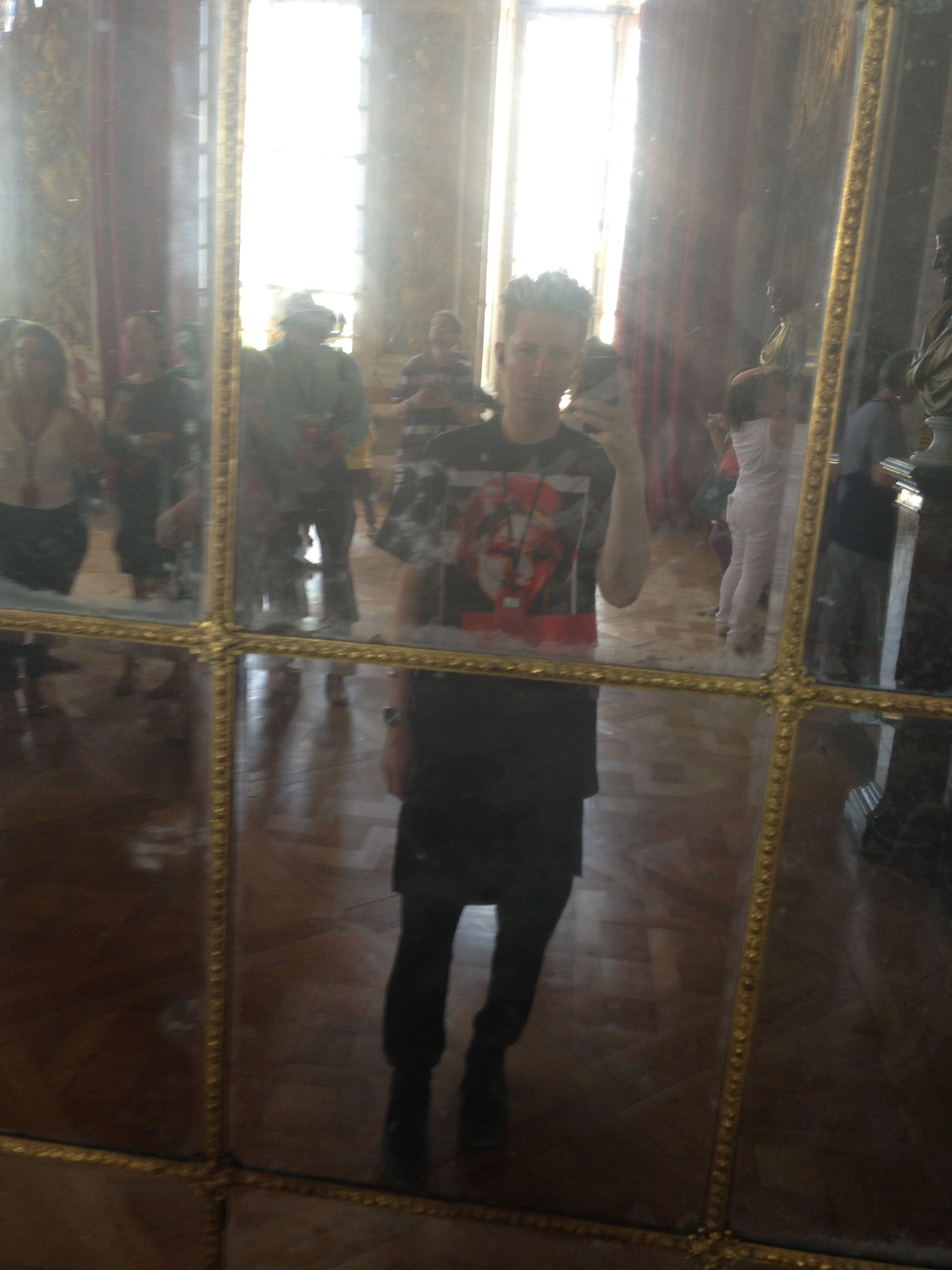 Me wearing givenchy at versailles in the hall of mirrors