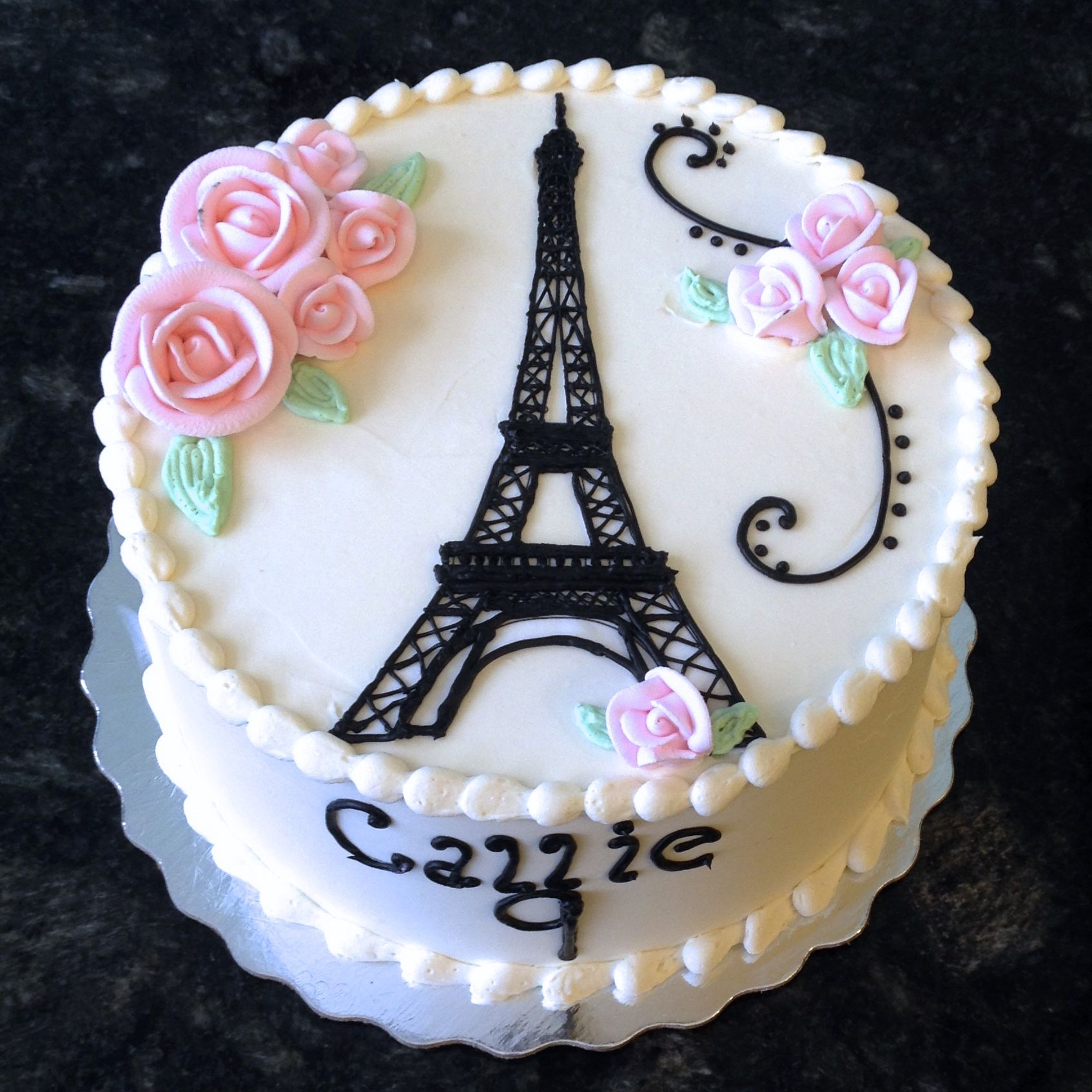 Pretty and feminine this Eiffel Tower cake is perfect for a