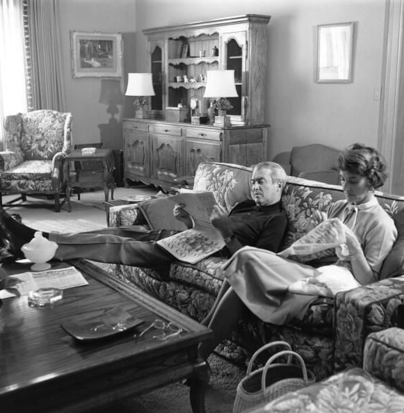 Jimmy Stewart relaxing at home with wife Gloria, 1960s