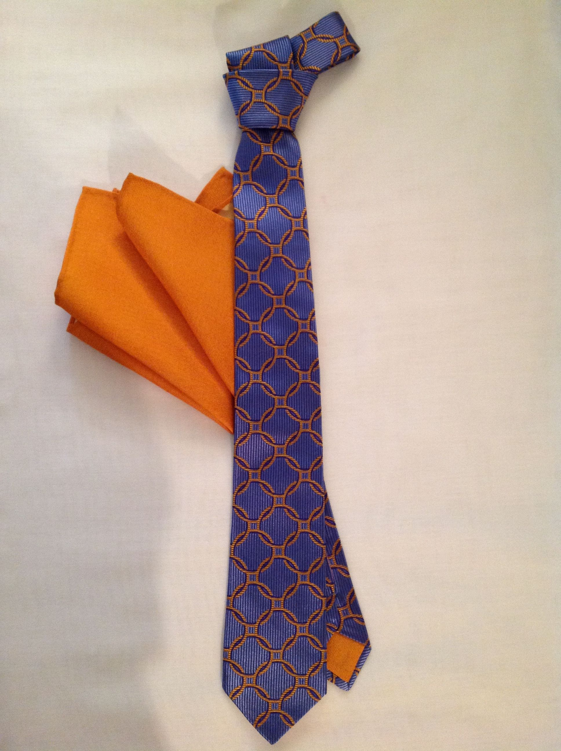 Italian Silk blue with navy and orange rings necktie with matching pocket square. www.Bitchinbowties.com