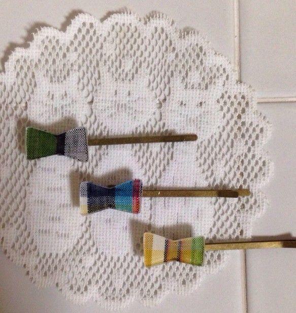 追加しました☆りぼんの形のプラバンにチェックの布を合わせました!りぼんの大きさ  縦 約1cm                           横 約2c...|ハンドメイド、手作り、手仕事品の通販・販売・購入ならCreema。