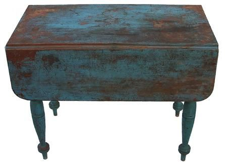 19th century New England drop leaf table, with old Robin Egg blue paint over the original red,, very gracefully turned legs, one board construction.ountry Treasures