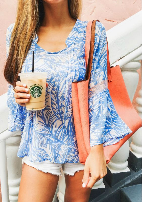 e2de1cc7e62 Statement prints + must have + effortless summer style + Jessi Afshin +  totally beach ready + blue and white printed bell-sleeve top + white denim  mini ...