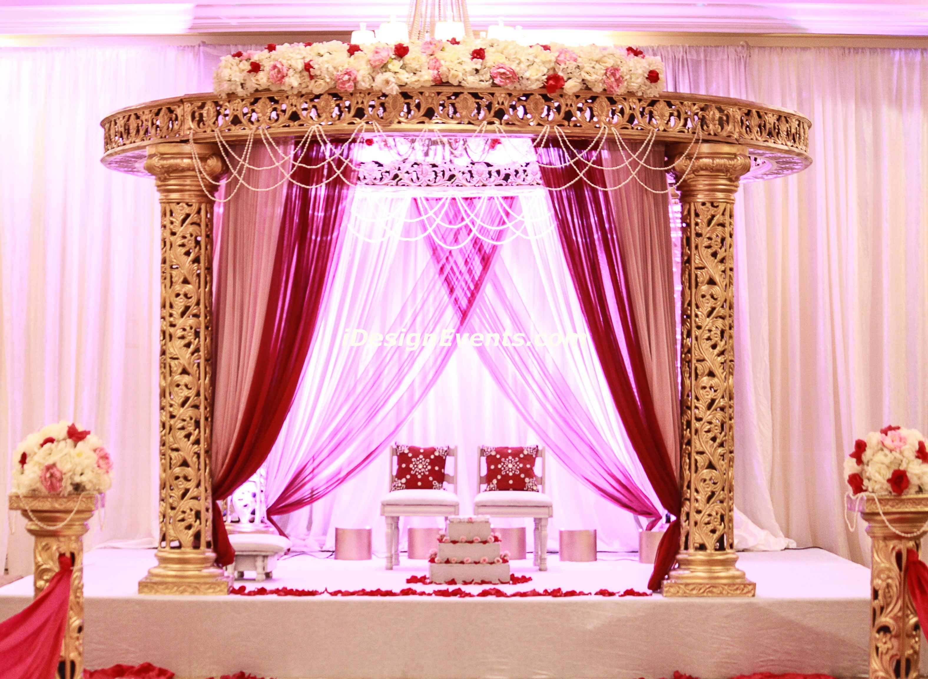 Round Gold Mandap With Mauve And Maroon Draping Crowned