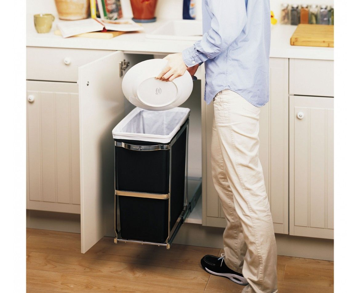 Keep trash concealed inside the cabinet. The simplehuman easy-to-install  pull-