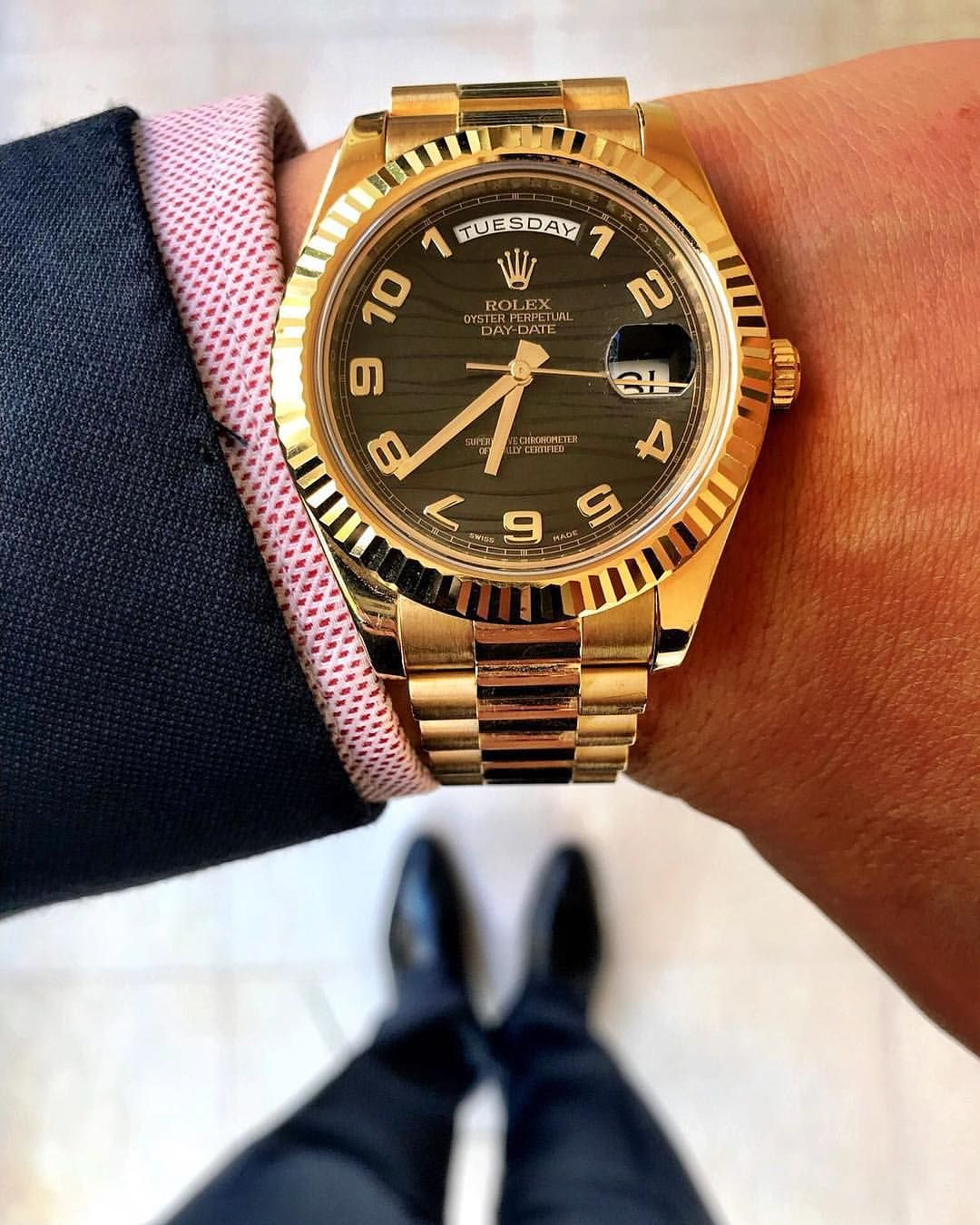 On the wrist here, the Rolex DayDate in Rose Gold. Photo