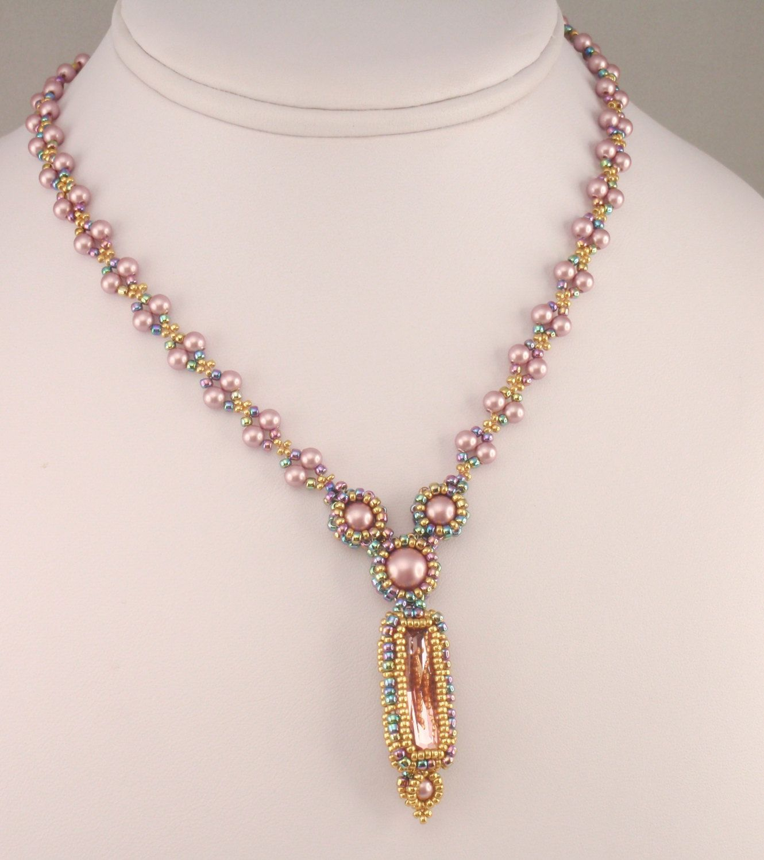 24X8mm Princess baguette (Swarovski #4547), 8mm glass pearls, 6mm glass pearls, 4mm glass pearls, 11/0 seed beads, 15/0 seed beads, thread, and Fireline