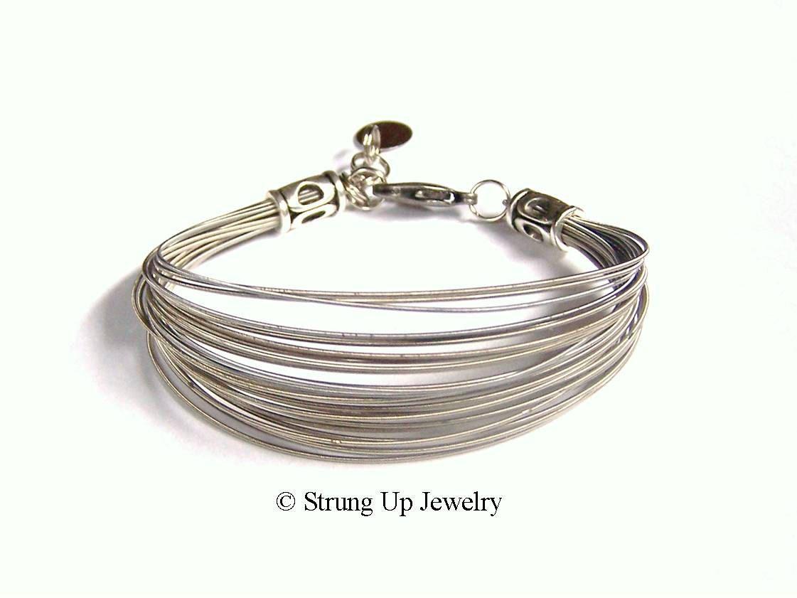 Recycled guitar string jewelry - Recycled Guitar String Multi Strand Bracelet Original Design 35 00 Via Etsy