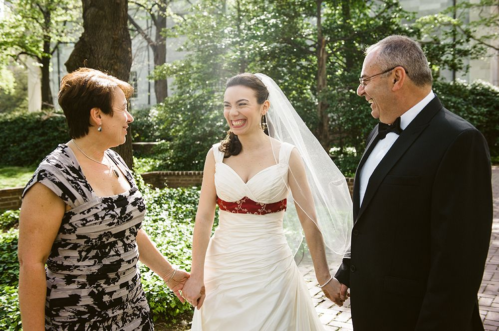 Bride And Parents Before Their Walk Down The Aisle