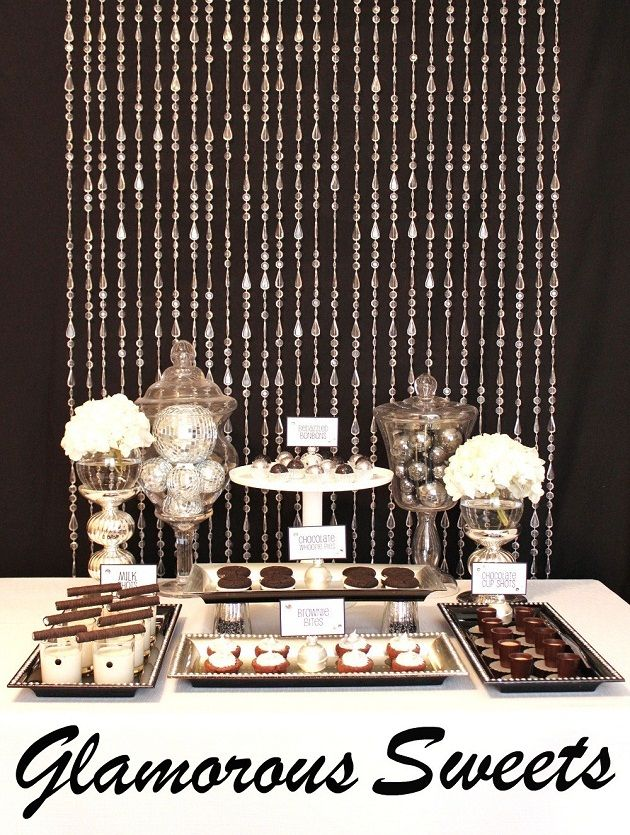 black and silver New Year's dessert table