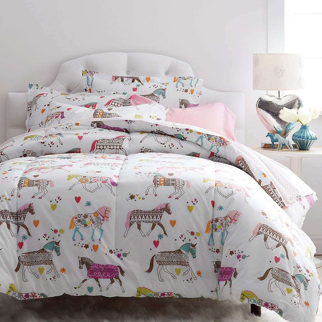supercozy kids comforter designed with a colorful carousel of horses made from