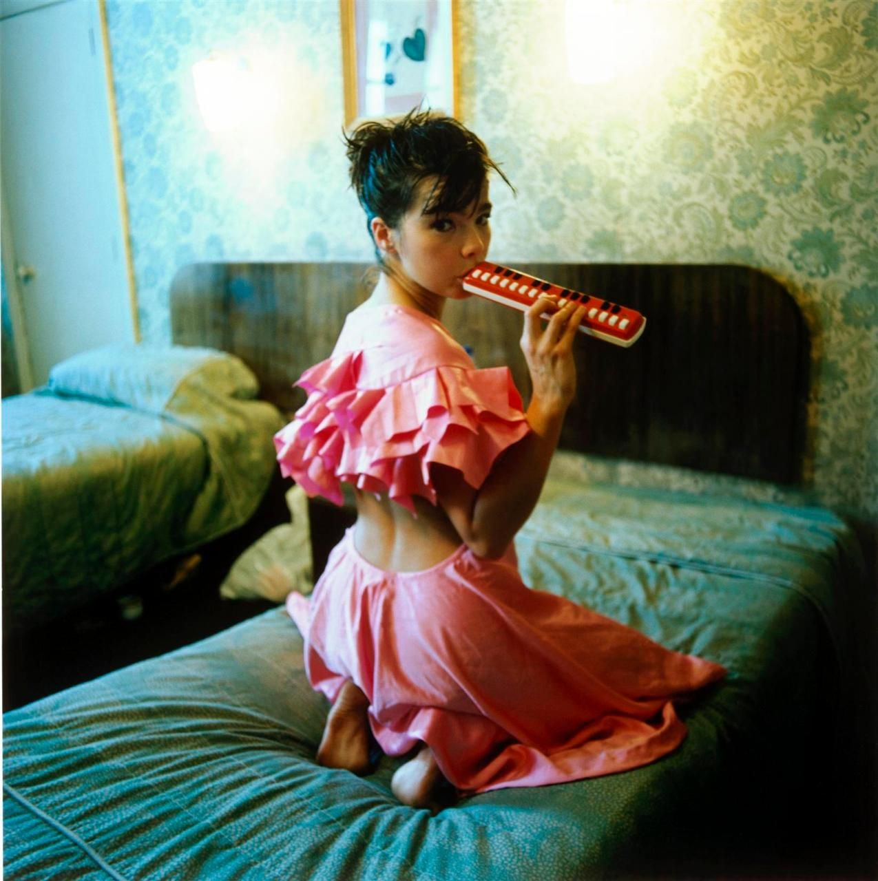 Björk with melodica.  Photographed by Glen Luchford, 1995