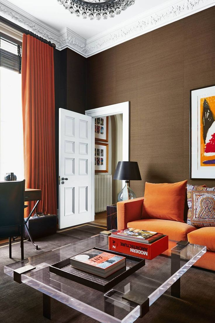 Modern living room ideas | House & Garden Brown grass cloth wallpaper in an orange room #livingroomfurniture #livingroomdesigns #livingroomcolor #livingroompaintcolorideas #livingroomdecorideas #livingroomdecoratingideas #livingroomdecorations #designsforlivingroom #familyroomideas #familyroomdesigns