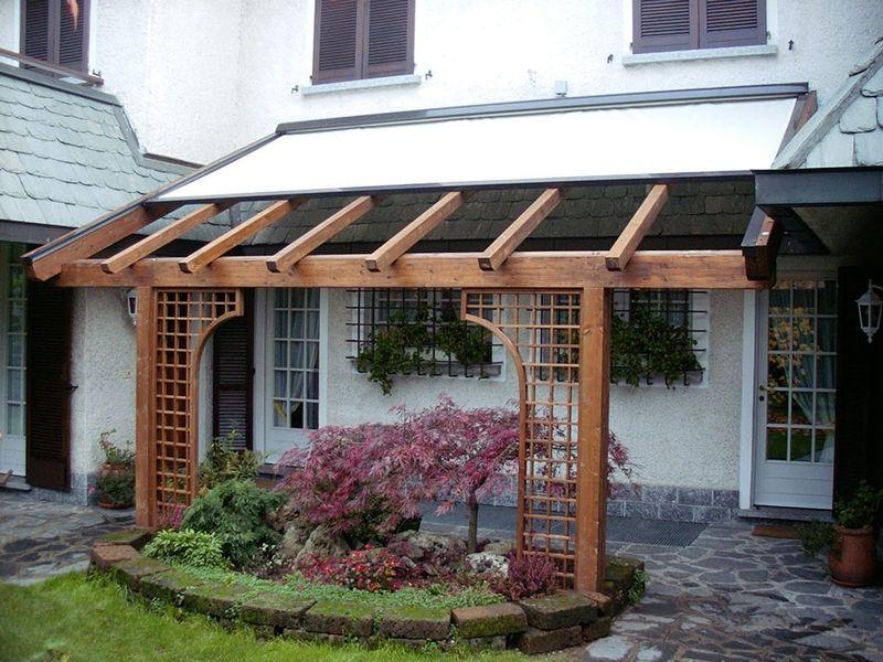 Pergola con tenda mobile arkilegno portico anteriore for Ville con portico in legno