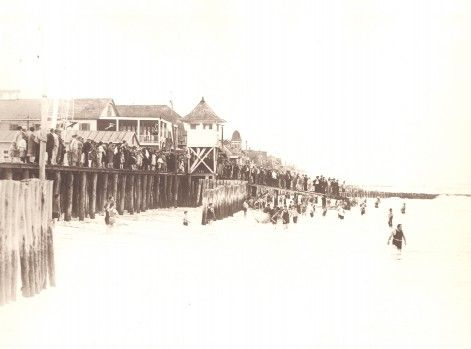 Collection of Janet & Daniel Trimper IV  There was no beach to speak of during the early 1930s. The ocean often spilled onto the side streets and flooded Baltimore Avenue.  Note the height of the boardwalk in those days and the large crowd gathered to watch the adventurous swimmers.
