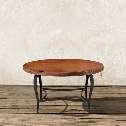 The Arhaus Normandy 38 Round Copper Coffee Table With An Iron