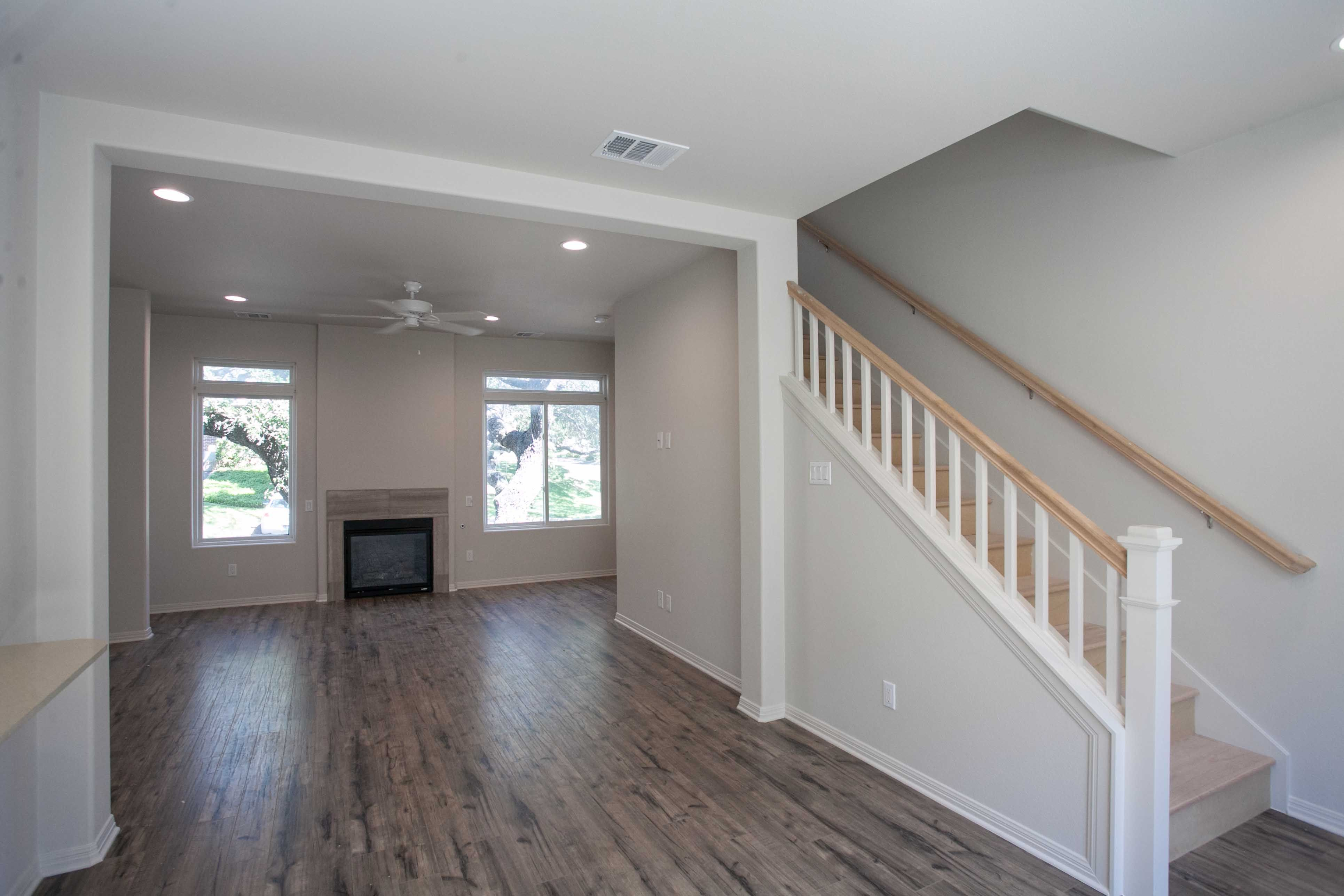 open living dining area with shaw laminate flooring and gas