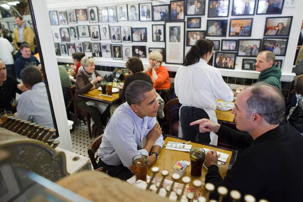 "https://flic.kr/p/962awY | P103010PS-0445 | Oct. 30, 2010 ""The President has lunch with Sen. Bob Casey at the Famous 4th Street Deli in Philadelphia. I love the woman in the background on the phone, probably alerting her family about her lucky seat."" (Official White House Photo by Pete Souza)  This official White House photograph is being made available only for publication by news organizations and/or for personal use printing by the subject(s) of the photograph. The photograph ma..."